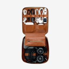 Tech Dopp Kit - by This is Ground Original - A zip-up organizer with a designated home for each of your tech accessories. With room on both sides to strap down your cords, adapters, headphones, and other necessities, the Tech Dopp Kit uses space wisely for prime portability.