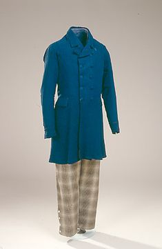 Blue silk crepe frock coat with brown and white checked wool trousers, Danish, c. 1850s. Starting in the 1840s, menswear typically consisted of frock coat, vest, trousers, shirt, and collar with cravat or necktie. Common colors for coats were black, blue, brown, green, gray, or burgundy, while pants were seen in a variety of woven patterns.