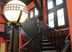 Beaches Library -interior staircase and lamp. Branch reopened after retrofit in 2005. Some of the original features from the 1916 building have been restored and emphasized by architect Phillip H. Carter, working with Kingsland + Architects. The impressive high ceiling has been restored, and duct work rerouted to show off the ceiling wood arches and a 'minstrel's gallery,' a loft at the north end of the building,,, Decor and lighting has been made to match the original Arts and Crafts style.