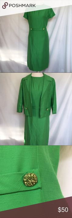 """Vintage Emerald Gown Totally mad men dress in pristine condition! It is a two piece emerald green suit with rhinestone buttons for decoration. Not a stone is missing on any of them. There isn't a flaw on this thing!! No holes, stains, or rips. The size is vintage so it does run smaller. The bust is 38"""", the waist is 37, and the hips measure 42"""". The dress is 42"""" long. Made by Henry Lee Vintage Dresses Midi"""