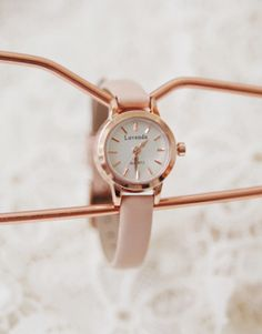 A nude-colored strap watch like this apricot pink accessory is a must-have. The neutral yet feminine color will match with most casual ensembles while the metallic gloss and analog style are just classic. - Analog dial - Round face - Leather strap watch - Multiple adjustments - Glossy metal hardware - Color: Apricot Pink
