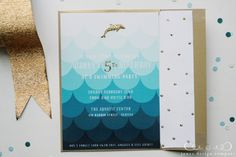 using gold glitter glue on invite created in Illustrator to emphasize dolphin and 5
