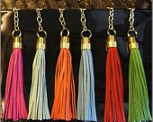 I want a leather tassel keychain or just to hang on my handbag--pretty!!!