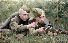 Two young twin Soviet Senior Sergeant snipers with what look like Mosin 91/30 rifles (the classic Soviet sniper rifle) fitted with the distinctive PU scope.