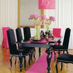Like the table set, not with pink though  Black and Gold Room Decor   ... and gold scrolled arm chair is right out of the era. Vintage opulence