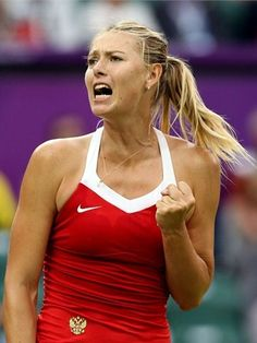 Maria Sharapova of Russia celebrates defeating Heather Watson of Great Britain in the second round of Women's Singles Tennis on Day 4 of the London 2012 Olympic Games at Wimbledon on 31st July