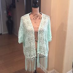 Shrug final price drop   listing Lace with fringe short sleeve kimono. Color very light green. Active Sweaters Shrugs & Ponchos