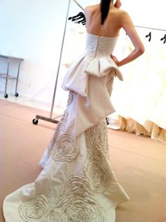 """The Amsale """"Lexington"""" gown features a peplum over hand pleated taffeta floral embroidery.   (Photo via l'atelier couture bridal) Like"""