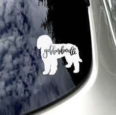 Goldendoodle Love Dog Moms Sticker Design: Goldendoodle Color: White Vinyl Size: *roughly, all my dog decals are roughly these dimensions, due to the shape differences of these breeds, they might slightly vary. H: 4.5in L: 5in Goldendoodle Lovers Unite. The perfect car