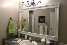 DIY bathroom mirror frame with white molding in gray and green bathroom. Easy Bathroom Updates for a More Luxurious Rental Apartment Classic Bathroom Mirrors, Bathroom Mirrors Diy, Simple Bathroom, Master Bathroom, Bathroom Ideas, Bathroom Inspiration, Design Inspiration, White Vanity Mirror, Mirror Trim