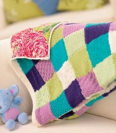 patchwork knitted blanket from letsknit.co.uk - pattern includes instructions for a ton of different stitches!