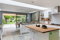 50 Degrees North Architects ground floor rear extension in South West London. Open-plan kitchen diner with large wall mural.
