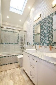 Utilizing glass mosaic tiles in custom blend coordinating with white circle glass mosaic, Large wavy tile, Custom vanity with a double sink, ...