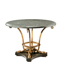 MARCEL-CHARLES COARD(1889-1975) Rare circular pedestal table in gilded wrought iron and green marble standing on a quadrangular base in wood imitating green marble. Signed «M.C COARD» and stamped with the parrot trademark . Circa 1940. 30 in. (76 cm) high, 42 1/2 in. (108 cm ) diam