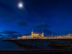 Brighton Pier illuminated on a clear night