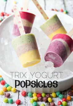 Trix Yogurt Popsicles - Imagine fresh fruits and sweet yogurt filled with tiny bits of fruity Trix cereal layered and then frozen to enjoy on hot summer days!