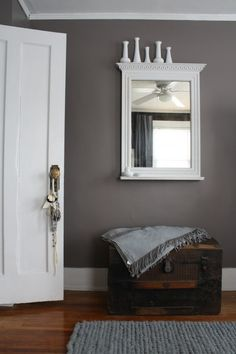 A vintage trunk and mirror flank one wall in our master bedroom.