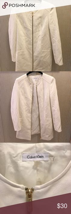 Calvin Klein white & cold blazer jacket chic xs Long goes a little bit above your knee. Size extra small. There are zippers on the sleeve and a zipper that goes from the bottom to the top on the front. It doesn't fit right on me so that's why it doesn't look good on me. Calvin Klein xs Calvin Klein Jackets & Coats Blazers