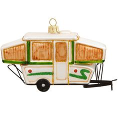 """Artfully crafted from glass with wire accents, this pop-up camper is a Bronner's exclusive and is sure make campers smile. Sold individually. Great for the outdoorsman! Dimensions: 2.5"""" H x 5"""" W Shipp"""
