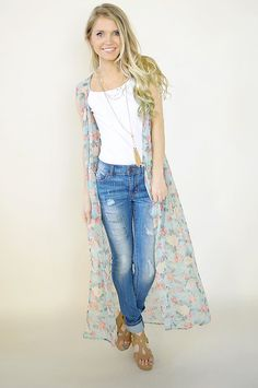 Sheer floral maxi vest with lace detailed back.