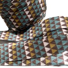 "Dark gray, yellow & mint tribal Aztec print 5/8"" fold over elastic FOE"