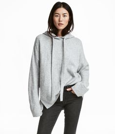 Oversized jumper in a soft, marled knit containing some wool with a drawstring hood, dropped shoulders, long sleeves and a wide, ribbed hem with slits in th Jersey Oversize, Oversized Jumper, Hooded Sweater, Grey Sweater, Sweater Cardigan, What Should I Wear Today, Sweater Shop, Grey Hoodie, Couture