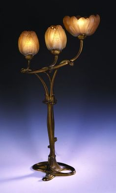 ">Louis Majorelle (1859-1926), ""Magnolia"" lamp with Daum shades."