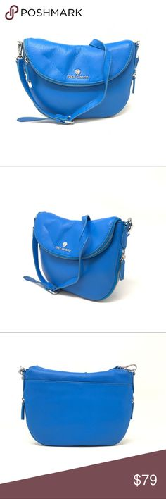 Vince camuto Electric blue Leather Ladies Rizo Bag This is new with defects  bag Vince Camuto Electric Blue Leather Women's rizo messenger cross-body bag. Deatchbale Shopulder strap.. Size-8*10*1 inch. Slightly discoloration on shoulder strap approx not visible Vince Camuto Bags Crossbody Bags