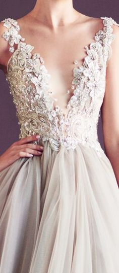 Look at the detail on this wedding dress! We might be in love...