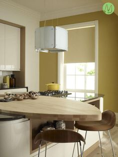 Choose eye-popping colours such as yellow and orange to achieve a retro look in your kitchen.