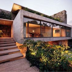 Contemporary garden and architecture in Mexico City by JJRR/ARQUITECTURA. The vegetation around the house is part of the total design, creating a beautiful contrast with the concrete, stone, steel and glass structure. (photo by Nasser Malek) Architecture Design, Residential Architecture, Contemporary Architecture, Contemporary Garden, Contemporary Stairs, German Architecture, Concrete Architecture, Contemporary Building, Contemporary Apartment