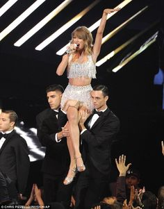 Lift off! Taylor was lifted into the air by two back-up dancers as she performed her latest shortly after being introduced by her 17-year-old gal pal Lorde
