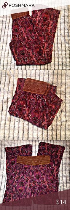 """Rue 21 paisley palazzo pants Rue 21 size small palazzo pants. 100% rayon. Purple and orange paisley design with brown band at top. 13"""" across the top at the front but stretches. 11"""" from waist to crotch. 30"""" inseam. Rue 21 Pants Wide Leg"""