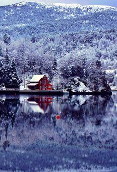 Snowy cabin on a remote lake