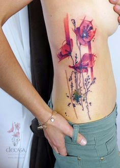 Blend of watercolor style and with a hint of mod photoshop styling on this ribcage of poppies tattoo