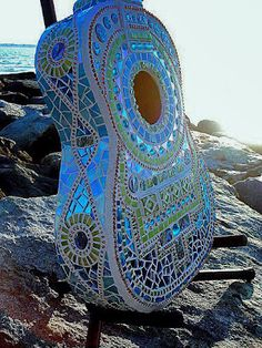 artist Lisa Calabro of Crooked Moon Studio in Warwick, Rhode Island. Lisa has transformed old instruments into artworks by mosaicing them. See more of her lovely mosaics on her website crookedmoonstudio...