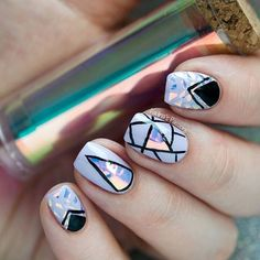 I was playing with my holographic foil for nails and here is the result I'm loving the geometric accents. Inspired by the talented @sohotrightnail