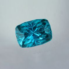 Apatite - Flat Faceted Carats: 23.53 carats Length x width: 18.4 mm x 13.3 mm Primary color: Blue Shape: Cushion Features: Rare/Unusual