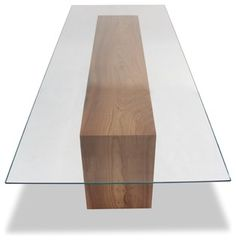 """Rectangular glass top dining table with double-fold solid wood base.Dimensions: 137""""L x 48""""D x 30""""H (1/2"""" Starphire glass)Rotsen Furniture creates"""