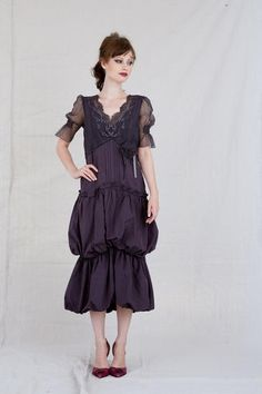 A gorgeous romantic vintage inspired Nataya dress featuring tulle lace, delicate taffeta, vintage detail, three quarter lengthsleeves.  In dark amethyst color.