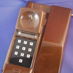 Contempra Phone Available in the 70s   Very modern design could be wall mounted. Still used a bell