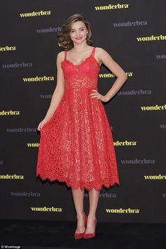 Lady in red! Miranda Kerr was a vision of elegance as she stepped out for a Wonderbra promotional event for in Seoul, South Korea on Tuesday