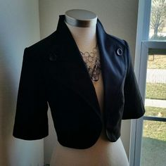 THE LIMITED....GORGEOUS BLACK .CROP .BLAZER... EXCELLENT CONDITION. .NEW LISTING...GORGEOUS CROP BLAZER....BETTER IN PERSON...YOU MUST GET THIS ONE..opens up front...has no buttons or zipper ...has 2 buttons as DECO. ..as shown on 2 pic..it's really nice...has no flaws...67% polyester 29%viscose 4%spandex LINING IS 100%POLYESTER.  .....TAKING OFFERS.... The Limited Jackets & Coats Blazers