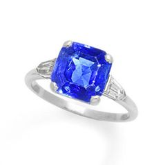 An art deco sapphire and diamond ring, by Cartier, circa 1925 The square-cut sapphire, weighing 5.06 carats, between tapered bullet-shaped diamond shoulders, signed Cartier, numbered, ring size M, maker's case