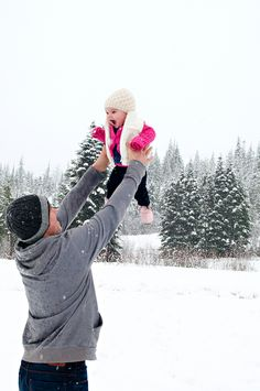 Adorable daddy + daughter moment in the snow!