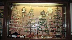 "Vintage ""Goose Feather trees"" with  beautiful antique ornaments.   Photo: Nat'l Christmas Museum"