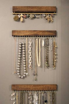 Jewelry wall display: 3 slats/narrow boards & hooks, plus one thin rod on hooks for earrings
