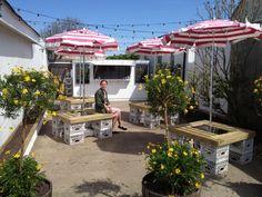 montauk milk bar - pop up beach - reuse milk crate tables Small Bar Table, Pop Up Cafe, Momofuku Milk Bar, New Hampton, Crate Table, Backyard Bar, Backyard Ideas, Milk Crates, Beer Garden