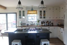 love this space - lights, simple tiles, white and dark cabinets