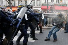 Demonstrators clash with CRS riot policemen near the Place de la Republique after the cancellation of a planned climate march ahead of the World Climate Change Conference 2015 in Paris, France.